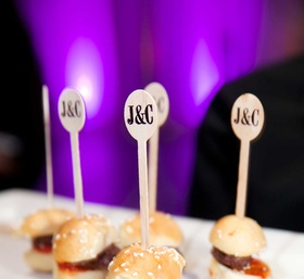Miniature hamburger slider with sesame seed bun and custom tooth picks