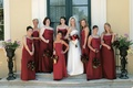 Bridesmaids and flower girl in red dresses with bride