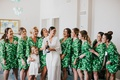 palm print green getting ready robes miami wedding bride in long white robe with flower girl match