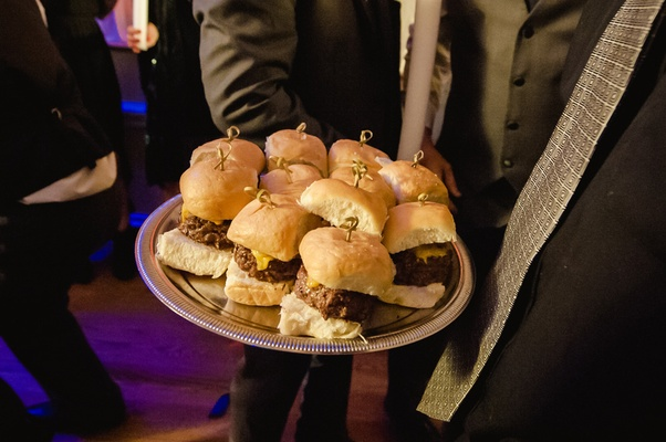 Silver platter topped with fresh buns and burger meat