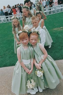 Flower girls and ring bearer in light green dresses and vests