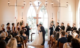Bride and groom kiss at church chapel wedding montage palmetto bluff in south carolina bridesmaids