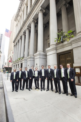 Groom and groomsmen in front of NYC building in sunglasses