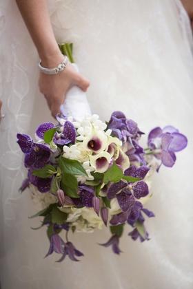 calla lily, stephanotis blossom, purple orchid flowers, white roses bride bouquet wedding flowers