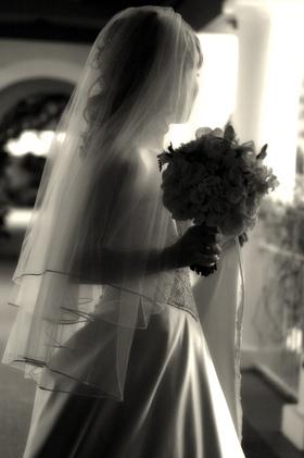 Black and white photo of bride's silhouette