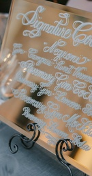 cocktail menu painted on gold mirror