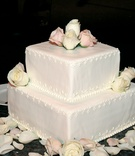 Two layer wedding cake with square layers and fresh roses
