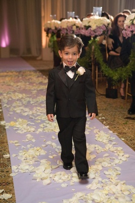 Little boy in tux sticking tongue out