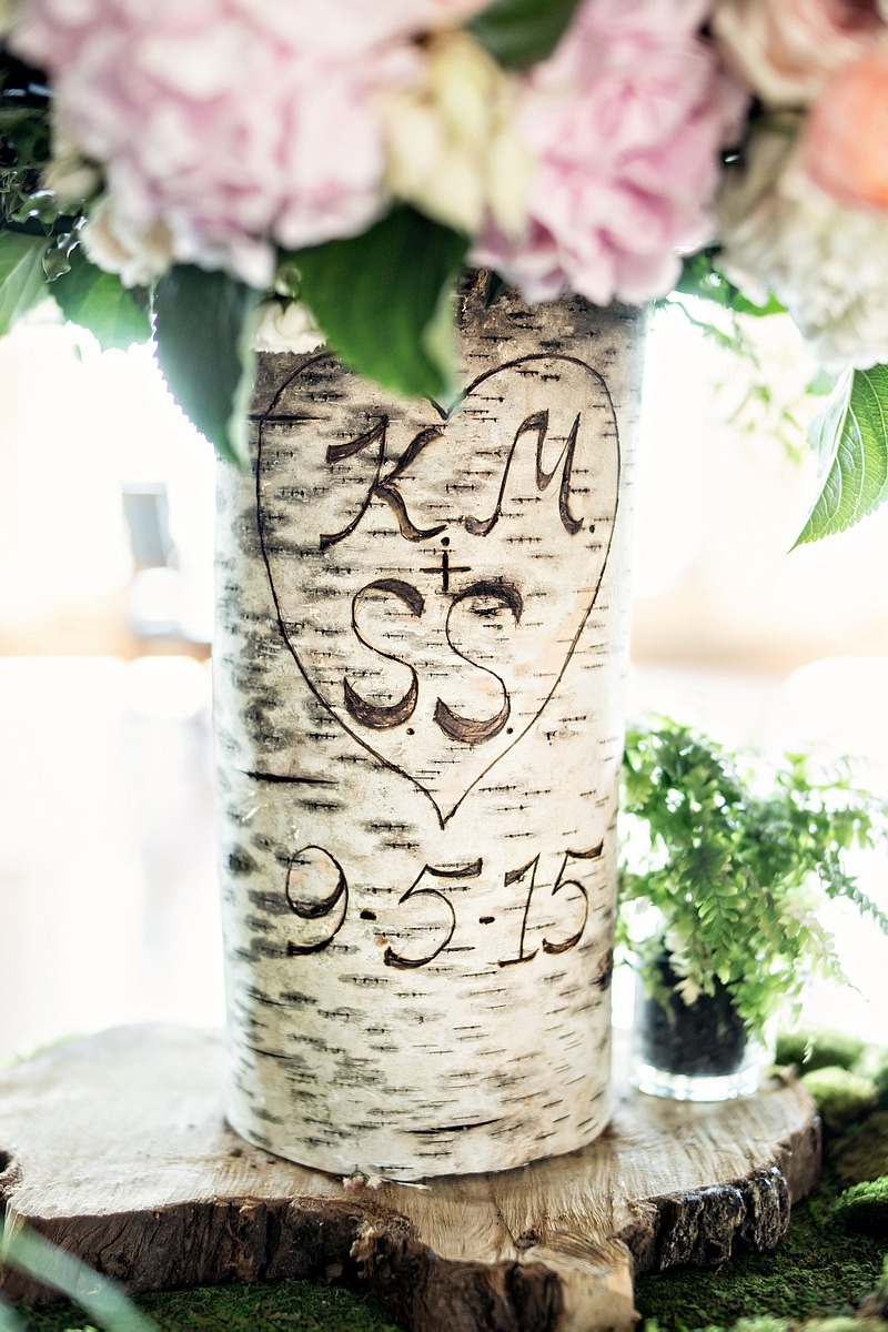 birch tree trunk as vase with initials and wedding date carved