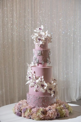 Purple wedding cake with silver details decorations and cascading white purple sugar flowers