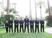 Wedding of Levine Toilolo NFL player with groomsmen in black suits ties tropical setting california