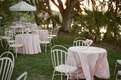 Great Gatsby-themed lawn party with white chairs