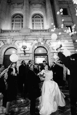 black white photo reception grand exit bride in fur wrap balloon release reception inspiration ideas