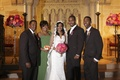 Bride and groom with mother father and brother