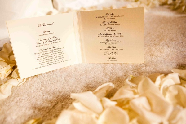 White stationery with black script ink font ceremony program