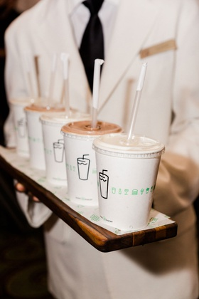 wedding reception surprise dessert milkshakes from shake shack on wood serving board
