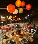Paper lanterns and colorful linens in barn
