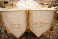 Bride and groom chairs with gold tassels