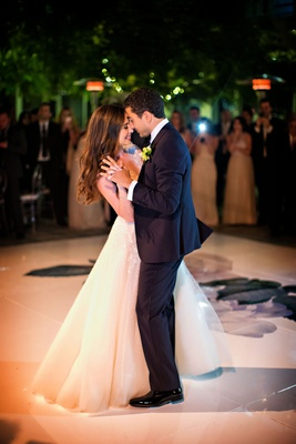 Dance floor with flower decal from invitation suite first dance wedding outdoor a line dress tuxedo