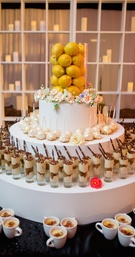 Three layer stand with desserts and lemon topper