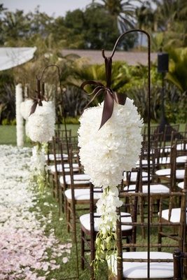 Wedding ceremony aisle decoration with shepherds hooks