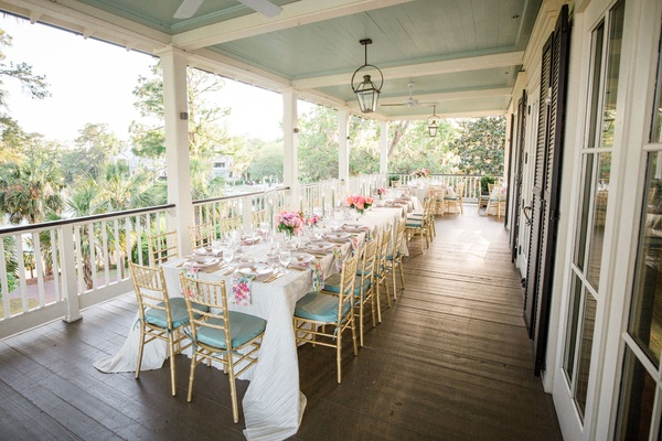 south carolina wedding reception overflow seating tables on wrap around porch pastel color palette