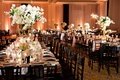 reception décor, black chairs, mirrored tables, floral centerpieces white flowers candlelight