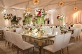 Wedding reception at Hotel Bel-Air with mid-century modern lighting chandeliers white chairs