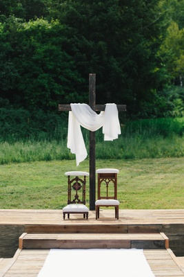 Cross at altar for wedding ceremony antique kneeler from church at front of ceremony