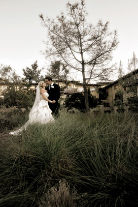 Bride in pick up skirt and groom in field at La Jolla's The Lodge at Torrey Pines