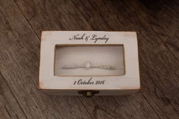 Wood jewelry box with wedding rings for Lyndsy Fonseca and Noah Bean