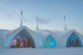 Hotel de Glace in Quebec City winter destination wedding ice castle chapel venue fur wrapped doors