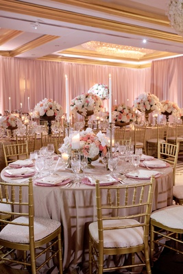 wedding reception gold chairs soft linens tall taper candles gold footed vessels pink white flowers
