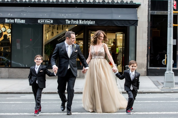 new family dad step mom kids crossing street wedding new york city sons ring bearers kids suits