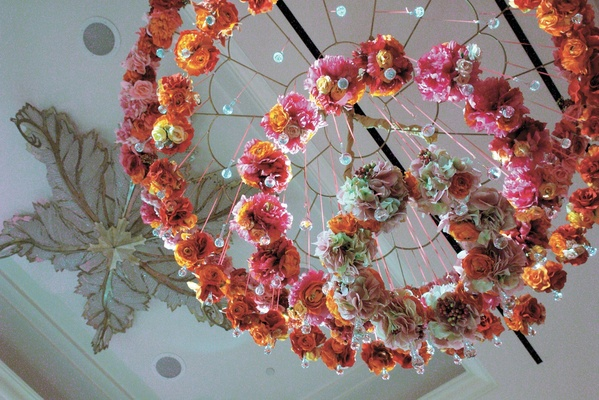 pink and orange flower rings hung from ceiling