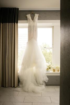 beaded berta mermaid wedding dress in front of window