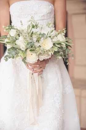 Neutral bouquet with greenery and garden roses, ranunculus blossoms with dangling ribbon