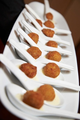 Wedding appetizers of a breaded ball served in spoons