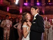 Newlyweds first dance in ballroom with Chorus Line dancers