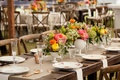 white vases on rustic wedding wood table with pink peony orange yellow flowers greenery rose gold