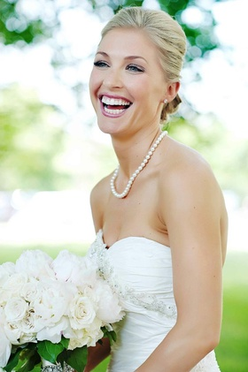 Blonde bride with pink lips and natural eye makeup