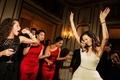 Bride in a Monique Lhuillier gown dances at reception