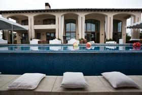 white pillows next to pool