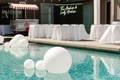 brandin cooks backyard wedding, pool with trendy matte white balloons floating
