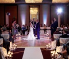 Indoor wedding in center of room with candles