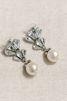 Bride's wedding day jewelry earrings with diamonds and drop pearls