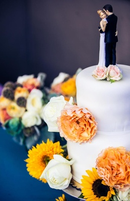 White two layer wedding cake with traditional cake topper