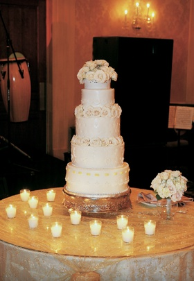 Small ivory wedding confection with candles