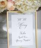 White menu calligraphy sip sip hooray wedding ideas calligraphy gold mirror translucent mat