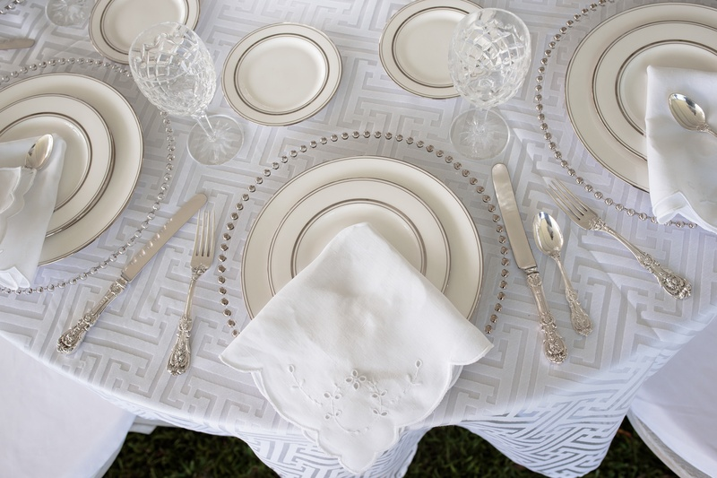 clear chargers with chrome dotted lining napkin with eyelet detail geometric linens & Reception Décor Photos - Modern Silver and White Table Setting ...